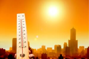 heatwave-in-the-city-and-hand-showing-thermometer-000025572542_Large